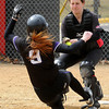 Bethany catcher Aimie Wiechmann prepares to tag on Northwestern's Ashley Krantz during fourth inning action on Friday.
