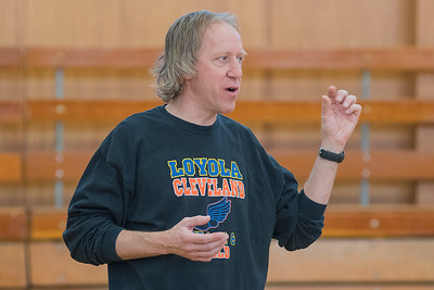 Mankato Loyola/Cleveland's boys and girls track coach Dale Compton talks to the two teams as they stretched in the Loyola gymnasium about the upcoming schedule. The teams have had to cancel and reschedule track meets due to inclement weather. Photo by Jackson Forderer