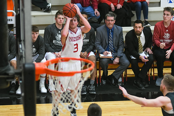 Bethany Lutheran's Austin Bauer measures up a three-point shot in a game played against North Central on Jan. 17. Photo by Jackson Forderer