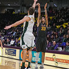 Minnesota State's Chris Kendrix (33) shoots a three-pointer over Bemidji State's Logan Bader in a game played at Bresnan Arena on Jan. 27. Photo by Jackson Forderer