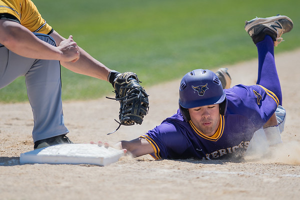 Mitch Frederick of Minnesota State slides safely back to first base after nearly being tagged by Wayne State's Bryce Bisenius. MSU lost to Wayne State 9-5. Photo by Jackson Forderer