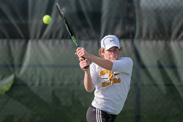 Mankato East's Jack Braswell hits a backhand against his Mankato West opponents in the No. 1 doubles match played at West on Thursday. East won the contest 4-3. Photo by Jackson Forderer