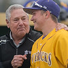 Former Minnesota State baseball coach Dean Bowyer (left) talks with Jack Mattson (11) before the start of MSU's double-header against St. Cloud State University on Thursday. Before the start of the game, it was announced that the baseball field was renamed to Bowyer Field. Photo by Jackson Forderer
