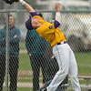 Minnesota State's Dylan Dresel leans backwards to make a catch in foul territory in MSU's double-header against St. Cloud State. The Mavericks lost the first game, snapping their long winning streak. Photo by Jackson Forderer