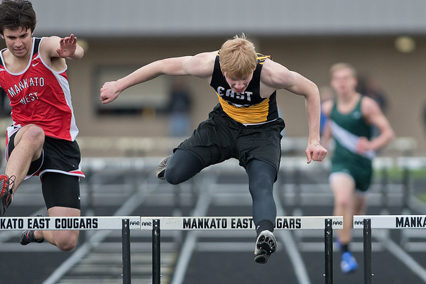 Mankato East's Ben Ziegler clears the last hurdle in the 300-meter hurdle race on Tuesday. Ziegler took first with a time of ??. Photo by Jackson Forderer