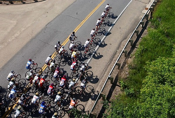 Pat Christman<br /> The peloton rides along State Highway 66 during the men's race Saturday.