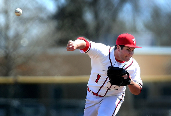 Bethany Lutheran College's Cory Ferm delivers a pitch during the first game of a doubleheader against Crown College Saturday.