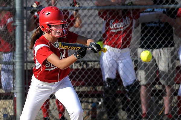 Mankato West's Lexy Schoper squares to bunt during their game against Shakopee Friday at the West field.