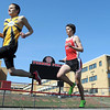 Mankato East's Micah Warning and Mankato West's Tyler DeFor make their way around the track during the 4x800 meter relay Thursday.