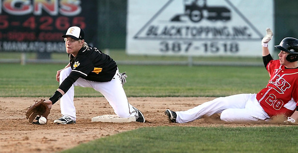 Mankato West's Steven Nessler slides slafely in to seocond base ahead of the throw to Mankato East's Dylan Findlay during the second inning Friday at Wolverton Field. Photo by Pat Christman