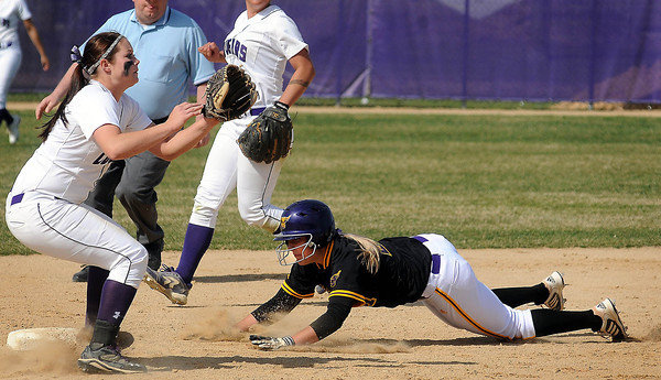 Minnesota State University's Molly Sager dives safely into 2nd base beating Sioux Falls' Brittany Hoffman's tag during fifth inning action of the opening game of a double header on Tuesday. Photo by John Cross.