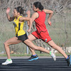 Mishya Rowe-Swanson passes a John Marshall runner on her way to winning the 400 meter dash on Tuesday. Photo by John Cross