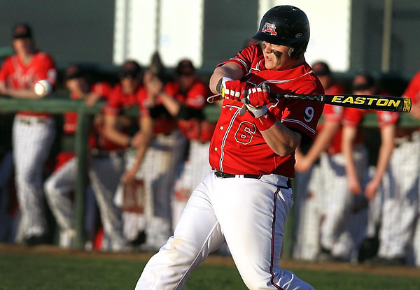 Mankato West's Conor Wollenzien hits a two-run single during the first inning against Mankato East Friday at Wolverton Field. Photo by Pat Christman