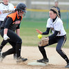 Farmington's Amber Doyle makes it back to second base ahead of the throw to Mankato East's Kayla Fingerson during the championship game of the Cougar Softball Tournament Saturday at Caswell Park. Photo by Pat Christman
