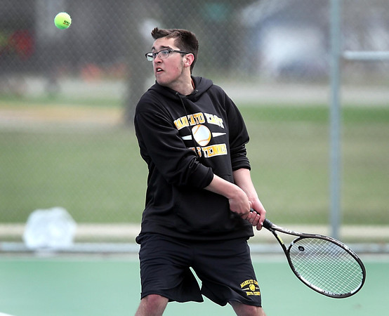 Mankato East's Chris Liu returns a shot Saturday at the East courts. Photo by Pat Christman
