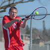 Mankato West's Aaron Erdman jumps up for a backhand volley in the number three singles match against Mankato East on Wednesday. Photo by Jackson Forderer