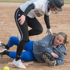 Lily Andrego of Mankato East reaches first base safely as Owatonna's Hannah Fisher fumbled the ball after a collision between the two in a game played at Caswell Park on Tuesday. Andrego and the Cougars won both games of their doubleheader against Owatonna. Photo by Jackson Forderer