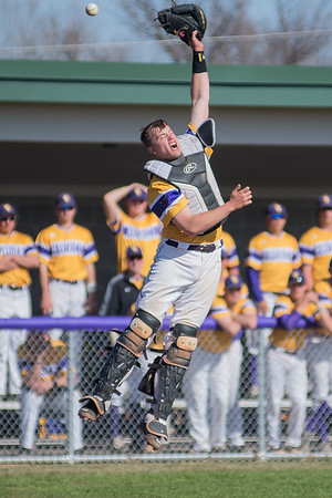 A throw to home plate goes over Minnesota State catcher Noah Bluth's head, allowing an Augustana runner to score in the second game of a double header played on Saturday. MSU split the two games with Augustana, losing the second game 4-2. Photo by Jackson Forderer