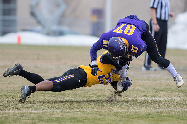 Minnesota State's Aarion Lacy (left) tackles Cullen Gahaggan at the MSU spring football game held at Blekeslee Stadium. Photo by Jackson Forderer