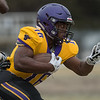 Minnesota State running back Charles Terry IV nearly breaks a tackle during Saturday's spring football game held at Blakeslee Stadium. Photo by Jackson Forderer