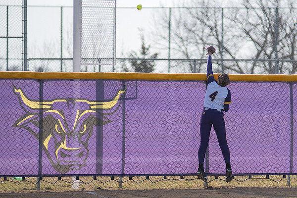 Minnesota State's Mckenzie Paap makes a last ditch attempt to catch a home run hit by Upper Iowa's Erin Drahozal. The three-run home run tied the game at five in the sixth inning, but the Mavericks rallied to score six of their own in the bottom of the inning and won 11-5. Photo by Jackson Forderer