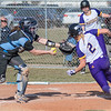 Minnesota State's Carly Esselman avoids a tag at home plate by Upper Iowa's Shannon Nix as the Mavericks rallied and broke the tie against the Peacocks in the second game of a doubleheader played on Wednesday. The Mavericks swept Upper Iowa 2-1 and 11-5. Photo by Jackson Forderer