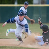St. Peter's Joseph Baron (left) gets the throw a split second too late to tag out Marshall's Nick Klaith at second base in the first game of a doubleheader played on Friday. Marshall took the first game 8-6. Photo by Jackson Forderer