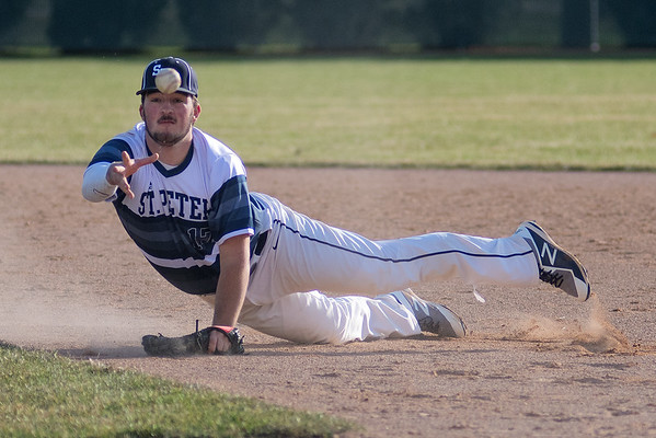 St. Peter first baseman Brock Bushaw flips the ball to teammate Isaac Peterson to try to get a force out at first base in Friday's doubleheader against Marshall. Between the two teams, there were 13 hits and nine errors, with Marshall winning the first game 8-6. Photo by Jackson Forderer