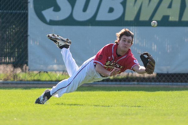Mankato West's Andrew Mihm tries to make a diving catch in Thursday's game against Mankato East. Mihm came up short on the attempt, and East blanked West 6-0 in the Big Nine conference game. Photo by Jackson Forderer