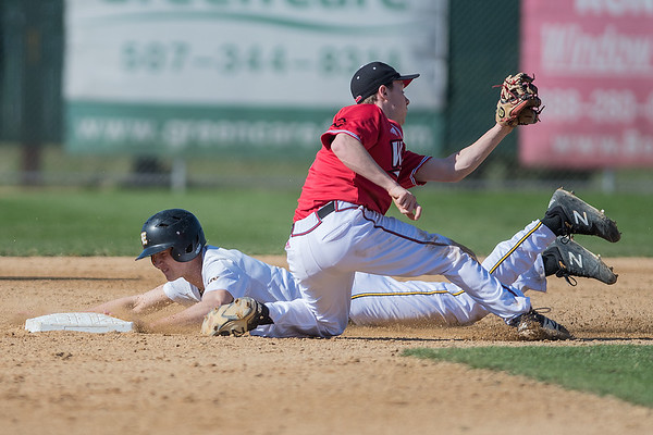 Mankato East's Ryan Kuechle successfully steals second base as Mankato West's Benjamin Hopper can't apply a tag in time during Thursday's game. East won the game 6-0. Photo by Jackson Forderer