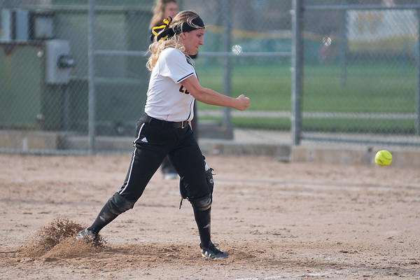 Mankato East's Morgan Keim-Wolfe delivers a pitch to a Cretin-Derham Hall batter in the Cougars opening game of the Mankato East Invitational tournament held at Caswell Park. Photo by Jackson Forderer