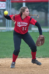 Kendra Porath (15) of Bethany Lutheran makes a throw to first during a game against Crown College on Thursday. Photo by Jackson Forderer