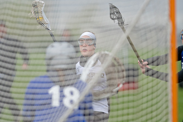 Ireland Olson of Mankato eyes Owatonna's goalie Maddie Seykora (18) before scoring a goal in the second half. Olson's two goals were not enough in Mankato's 7-10 loss against Owatonna on Tuesday. Photo by Jackson Forderer