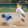 Minnesota State's Eric Peterson (right) jumps to catch a ball thrown to him as Upper Iowa's Mitch Moser slides into third base in the second game of a double-header played on Saturday. MSU won both games by scores of 3-0 and 12-2. Photo by Jackson Forderer