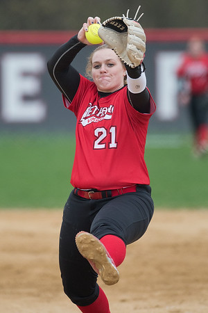 Bethany Lutheran's Anna Pipenhagen (21) delivers a pitch to a Crown College batter in Thursday's conference game. Photo by Jackson Forderer