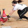 Mankato East's Macy Anderson tags out Mankato West's Tristin Danay at third base during their game Friday.  Photo by Pat Christman