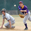 The University of Minnesota Crookston's Ryan Haggstrom looks on as Minnesota State University shortstop Jon Heiderscheit tries to turn the double play during the first game of their doubleheader Saturday at the MSU field.  Photo by Pat Christman