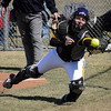 Maverick catcher Chelsea Riordan snags a foul tip during fifth inning action with Upper Iowa University on Thursday.<br /> Photo by John Cross