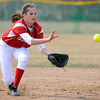 Mankato West's Emily Veroeven runs down a pop fly during their first round game against New Prague in the Scarlets Softball Tournament Saturday at Caswell Park.  Photo by Pat Christman