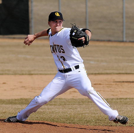 Gusties pitcher Chris Kelly went the distance giving up five hits in a 5-3 win in the first game of a doubleheader with Augsburg College. Photo by John Cross