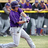 Minnesota State's Nolan Johnson hits a two-run double during Saturday's game against Minnesota Crookston. Photo by Pat Christman