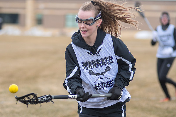 Hanna Helms of the Mankato girls lacrosse team catches a pass thrown to her by a teammate during a scrimmage at practice on Wednesday. Helms is a senior forward on the team. Photo by Jackson Forderer