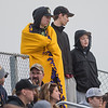 Riley Gruenes (left), 15, stays warm in a blanket while watching the Mankato East versus Mankato West baseball game at Wolverton Field on Thursday. Photo by Jackson Forderer