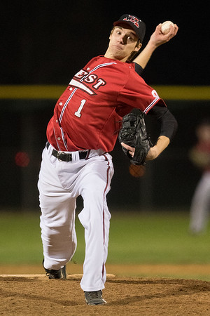 Evan Furst of Mankato West delivers a pitch against a Mankato East batter at Franklin Rogers Park on Thursday. Furst pitched a one-hit shutout for the Scarlets in their 3-0 win. Photo by Jackson Forderer