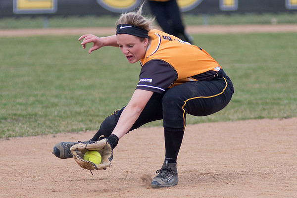 Shortstop Rachel Malo of Gustavus snags a ground ball in the first of two games played against St. Scholastica on Friday. Gustavus split their non-conference games against the Saints. Photo by Jackson Forderer