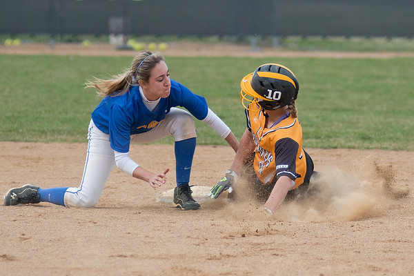 Gustavus' Caitlin Kammerer (10) gets tagged out at second base by St. Scholastica's Alexa Bremer in the first of two games played on Friday. Gustavus won the first game 8-0. Photo by Jackson Forderer