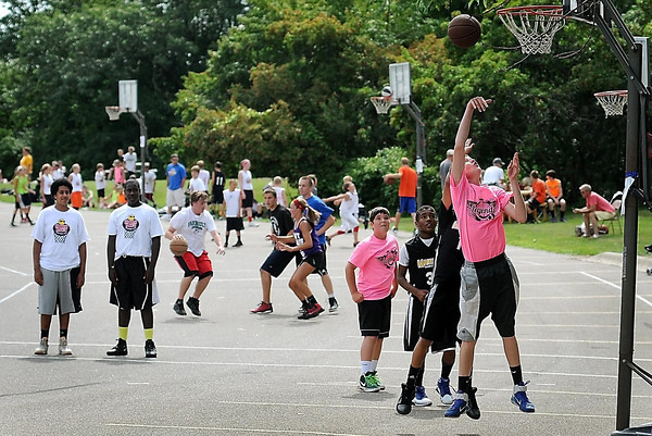 John Cross<br /> Teams compete on multiple courts during the Hoopin' On the Hill three-on-three basketball tournament at Good Counsel Hill on Saturday.