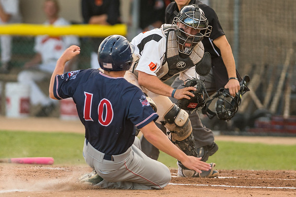 MoonDogs catcher Christopher Schaeffer waits to tag out Drew Avans (10) of the St. Cloud Rox at home plate during Friday's game played at Franklin Rogers Park. Photo by Jackson Forderer