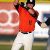 Mankato MoonDogs' Craig Massoni celebrates a third inning double during Thursday's game.