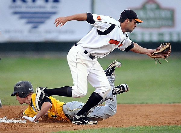 John Cross<br /> Willmar's Brennan Moore is safely into second after knocking the ball from Moondogs shortstop Chad Christensen's glove with his foot during a steal attempt.